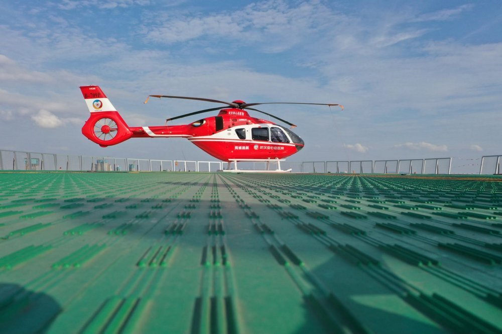 An in-flight view of Wuhan Yaxin Hospital's H135 rotorcraft used for HEMS (Helicopter Emergency Medical Services) missions.