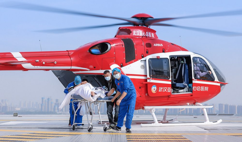 A patient is transferred to medical facilities via stretcher after being airlifted to Wuhan Yaxin Hospital onboard an Airbus-built H135 helicopter.