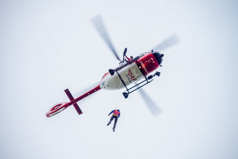 A DRF Luftrettung crew from the HEMS base in Bautzen performs rescue winch training with an Airbus-built H145 helicopter.
