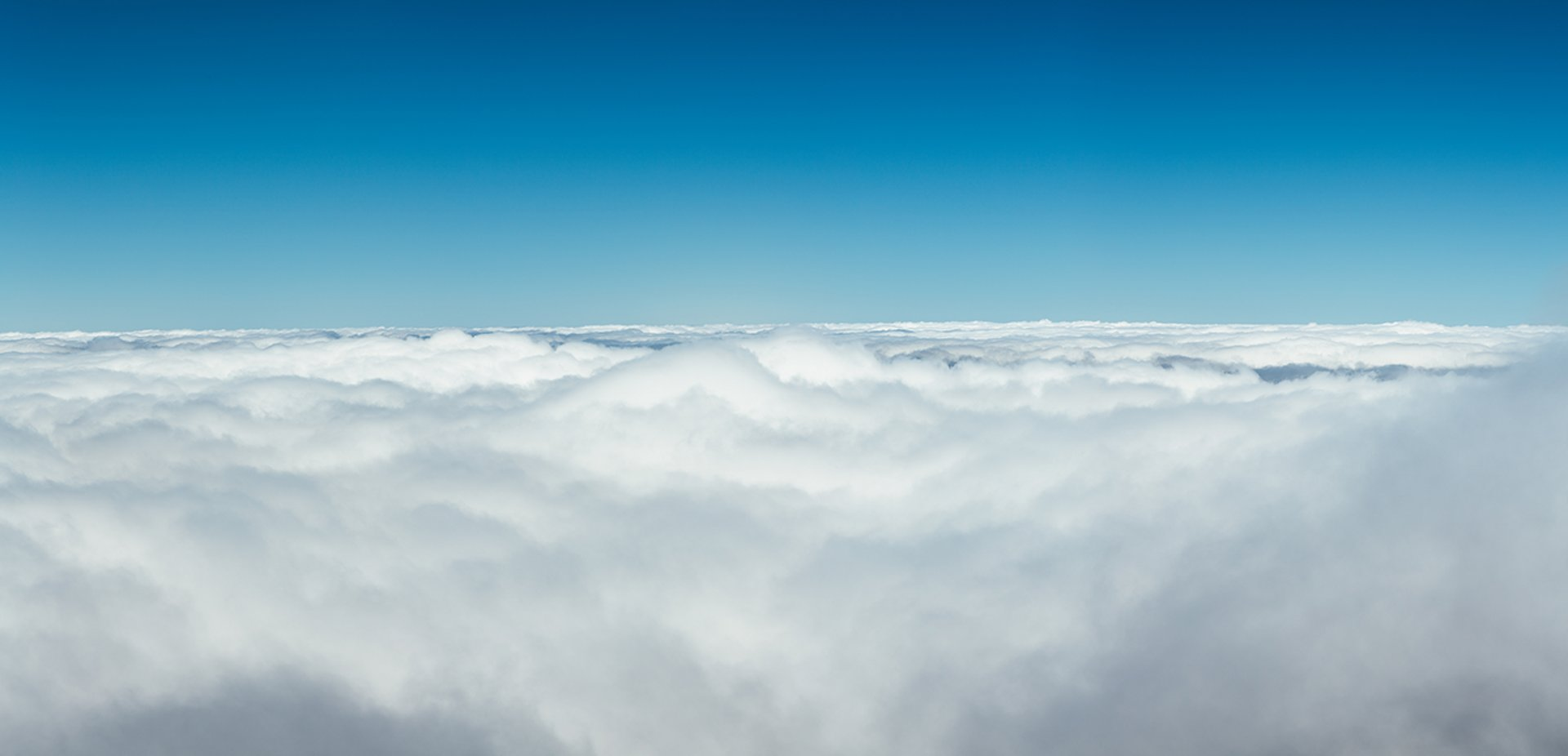 High above white fluffy clouds.