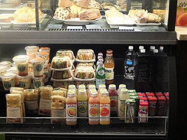 Starbucks fridge airport sandwich fruit juice milk panini