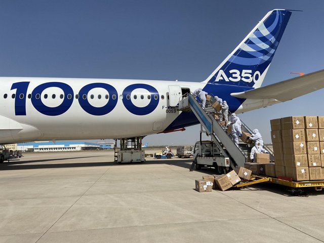 A shipment of four million protective face masks for healthcare systems in France, Germany, Spain and the UK are loaded aboard an Airbus A350-1000 aircraft in Tianjin, China on an air-bridge flight in April 2020