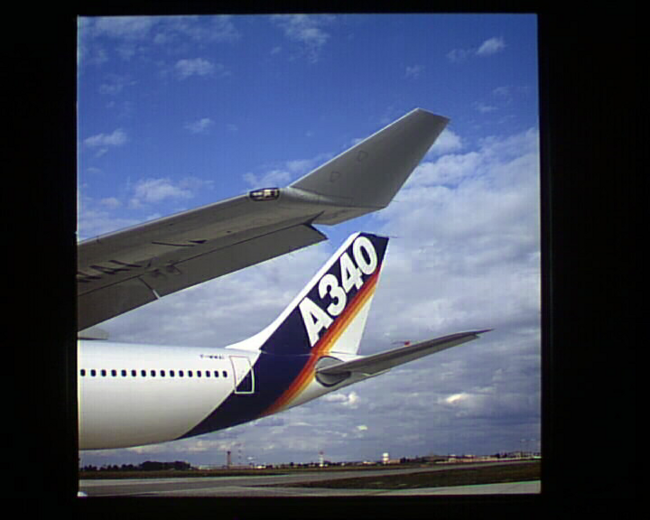 A340 300 Tail And Wing Tip
