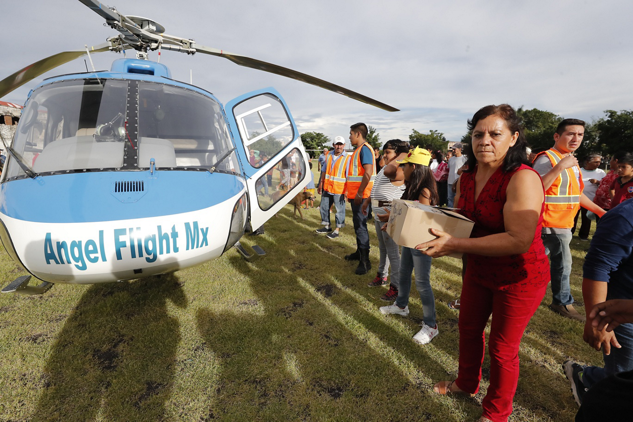 Relief supplies are unloaded from an Airbus-built helicopter as part of an Airbus Foundation-organized mission.