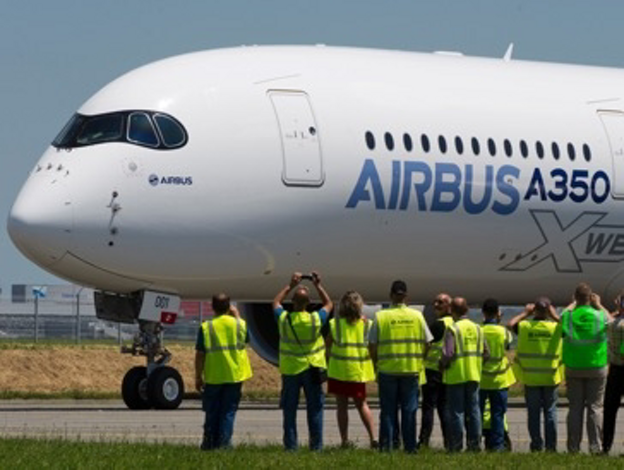 Airbus employees welcome home the no. 1 A350 XWB at the conclusion of its maiden flight.