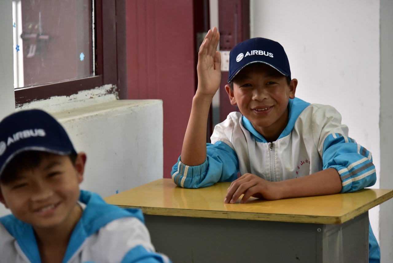 Two smiling students from the Beijing Guang Ai School in China.