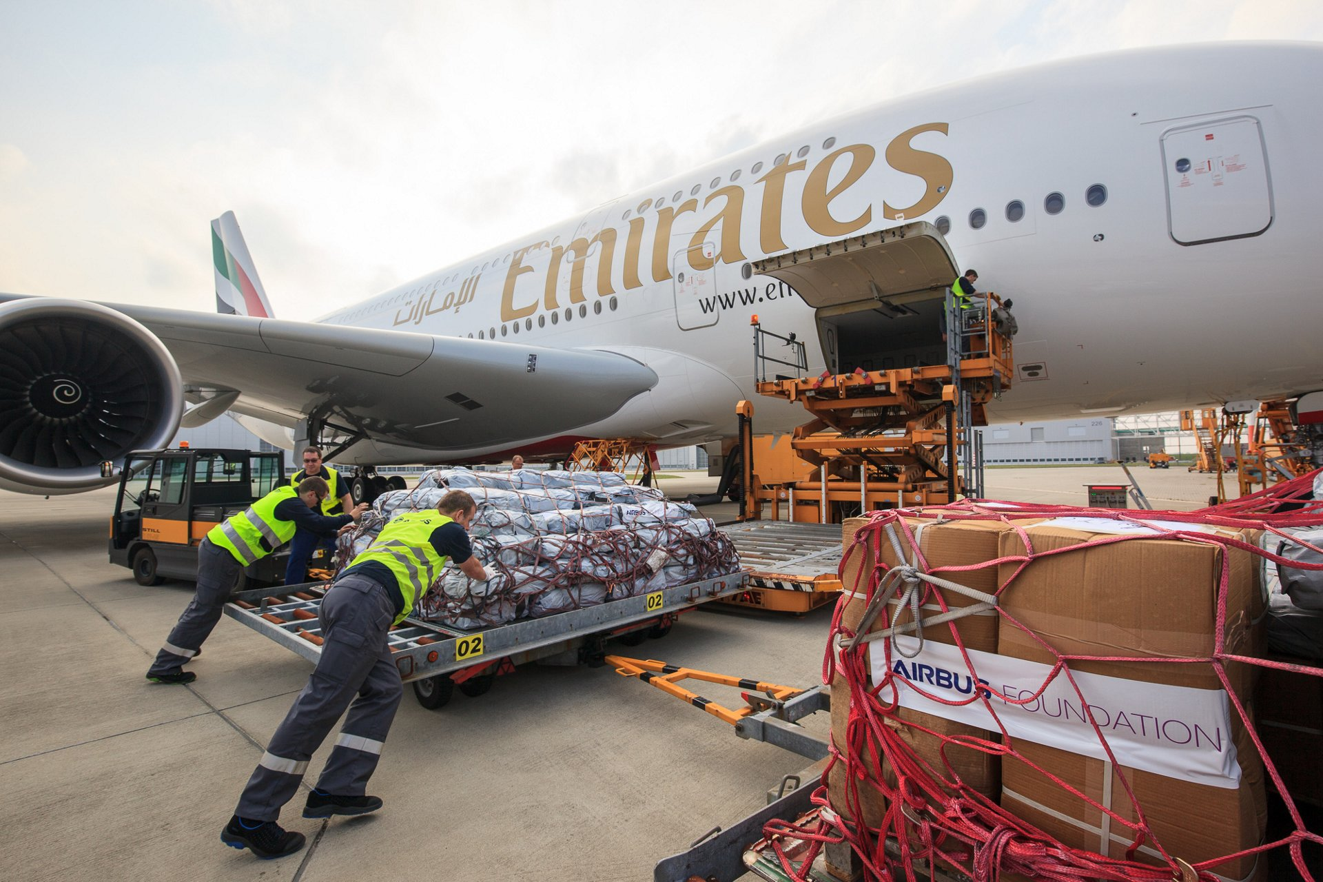 Emergency shelter items are loaded on board of an Emirates A380 flying from Hamburg to Dubai