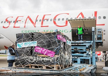 Loading of relief goods on Air Senegal's newest A330neo at Toulouse-Blagnac airport.