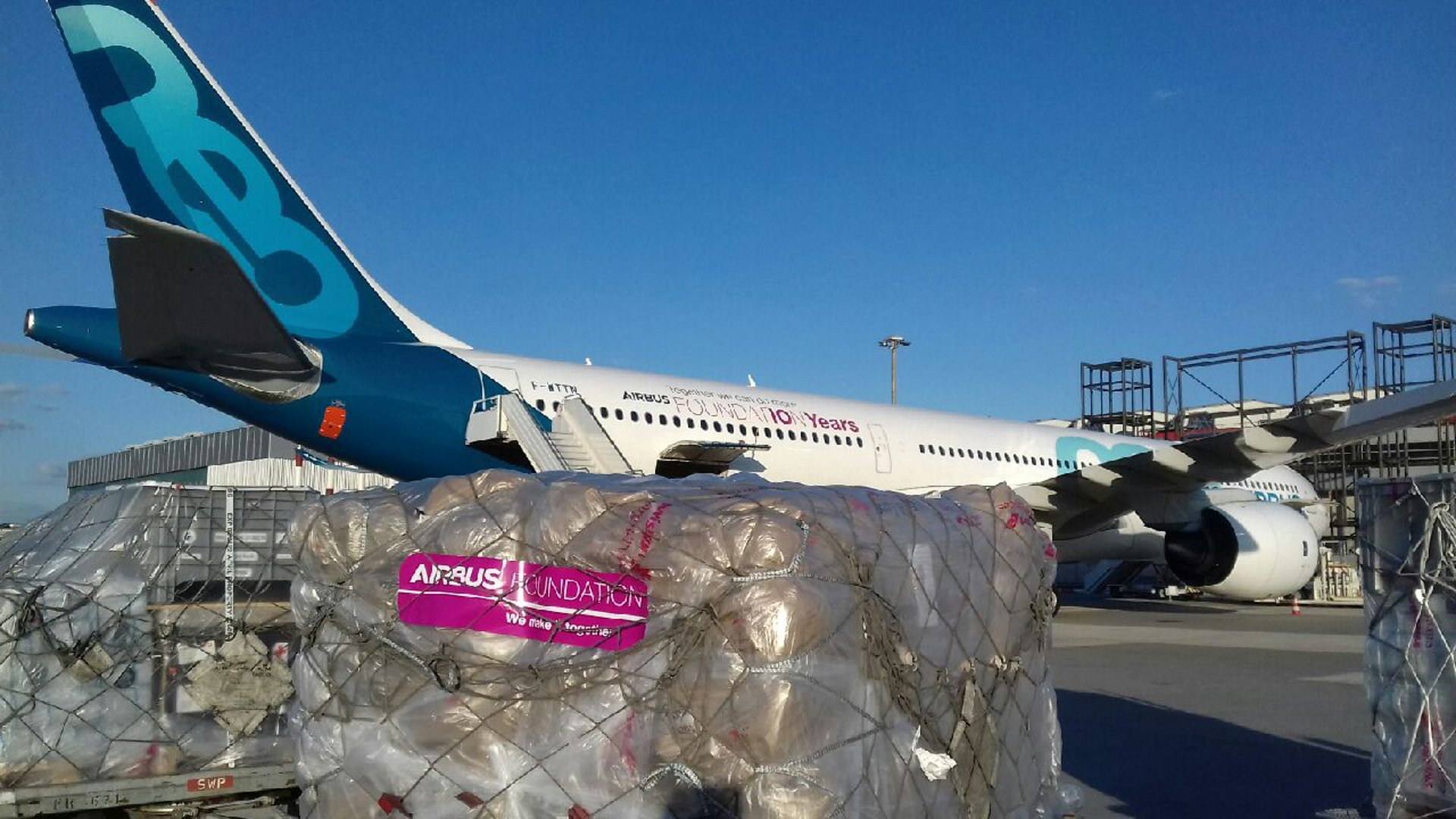 Loading of relief goods for victims of cyclone Idai on an Airbus A330neo test aircraft at Geneva Airport, Switzerland.