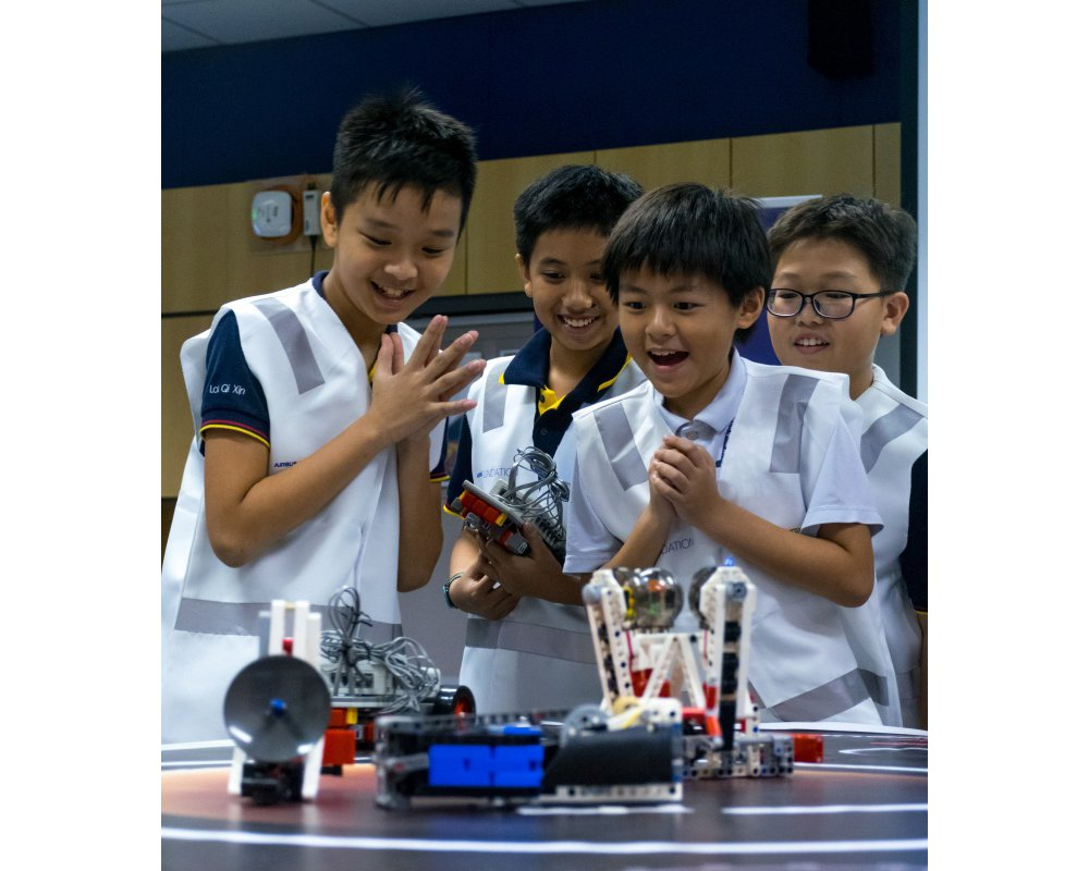Four students build a space base model as part of the Airbus Little Engineer programme.