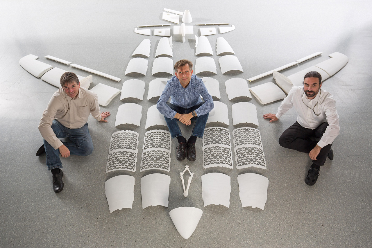 Detlev Konigorski, Gunnar Haase and Andreas Poppe (from left to right) with individual printed parts of the four-metre-long THOR project aircraft