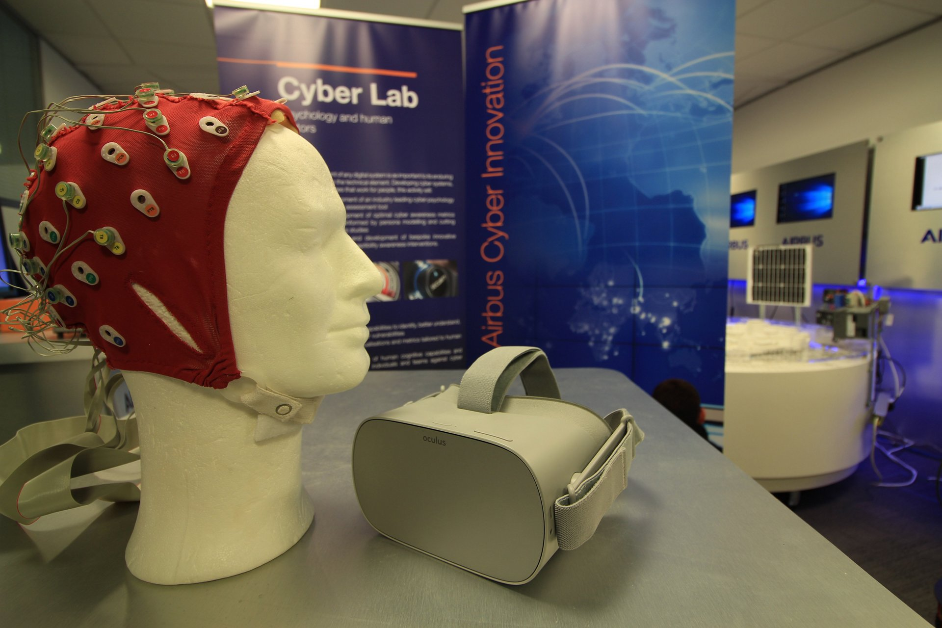 An exhibit stand promotes technologies related to CyberLab, a major security research initiative jointly funded by the Welsh government and Airbus.