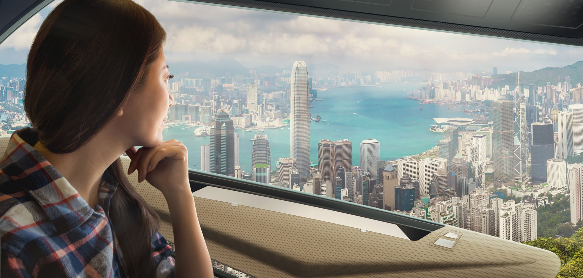 This futuristic image shows a passenger inside an Airbus electric vertical take-off and landing (eVTOL) vehicle, lookingout the window.