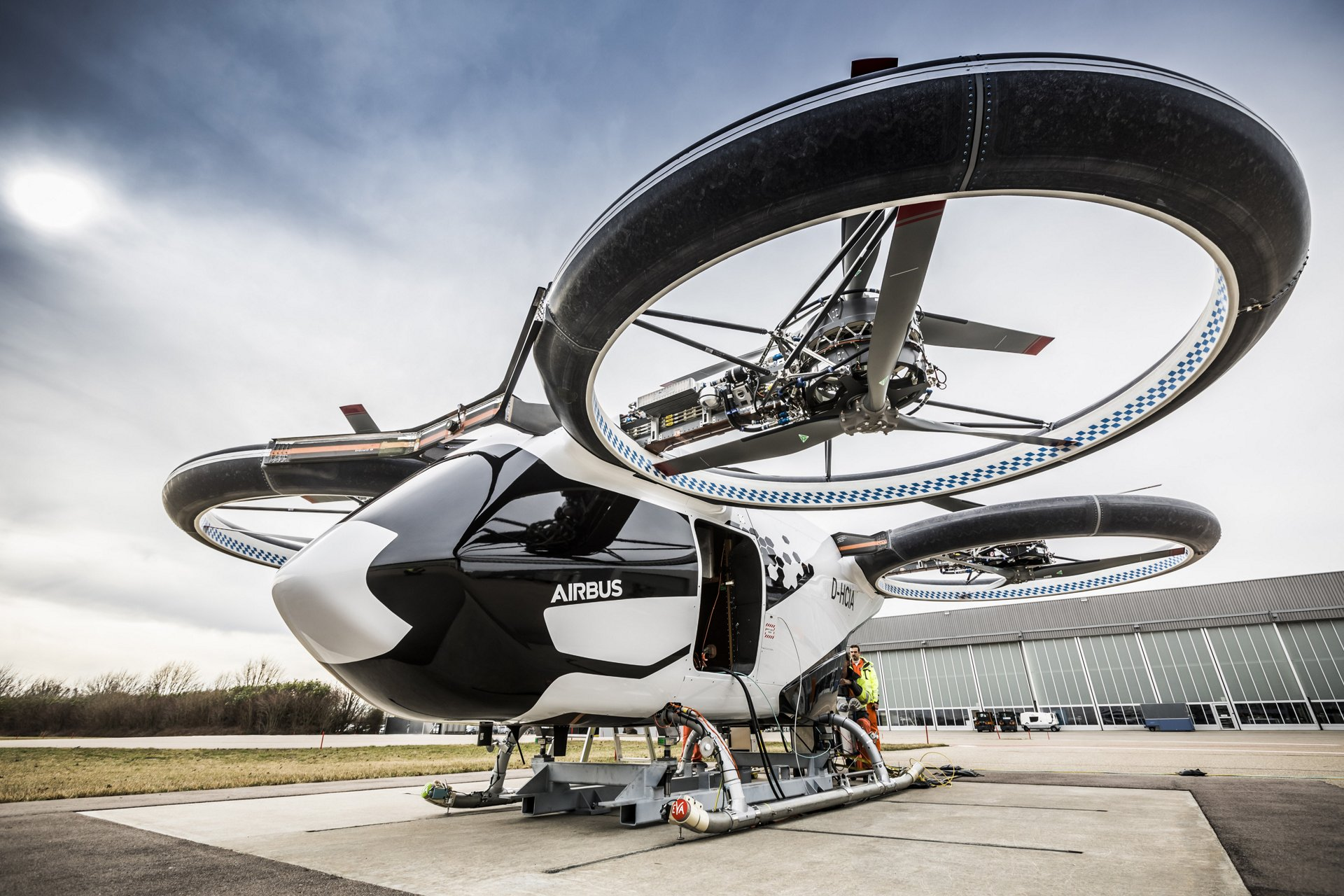 An on-ground photo of the all-electric, four-seat multicopter demonstrator called CityAirbus.