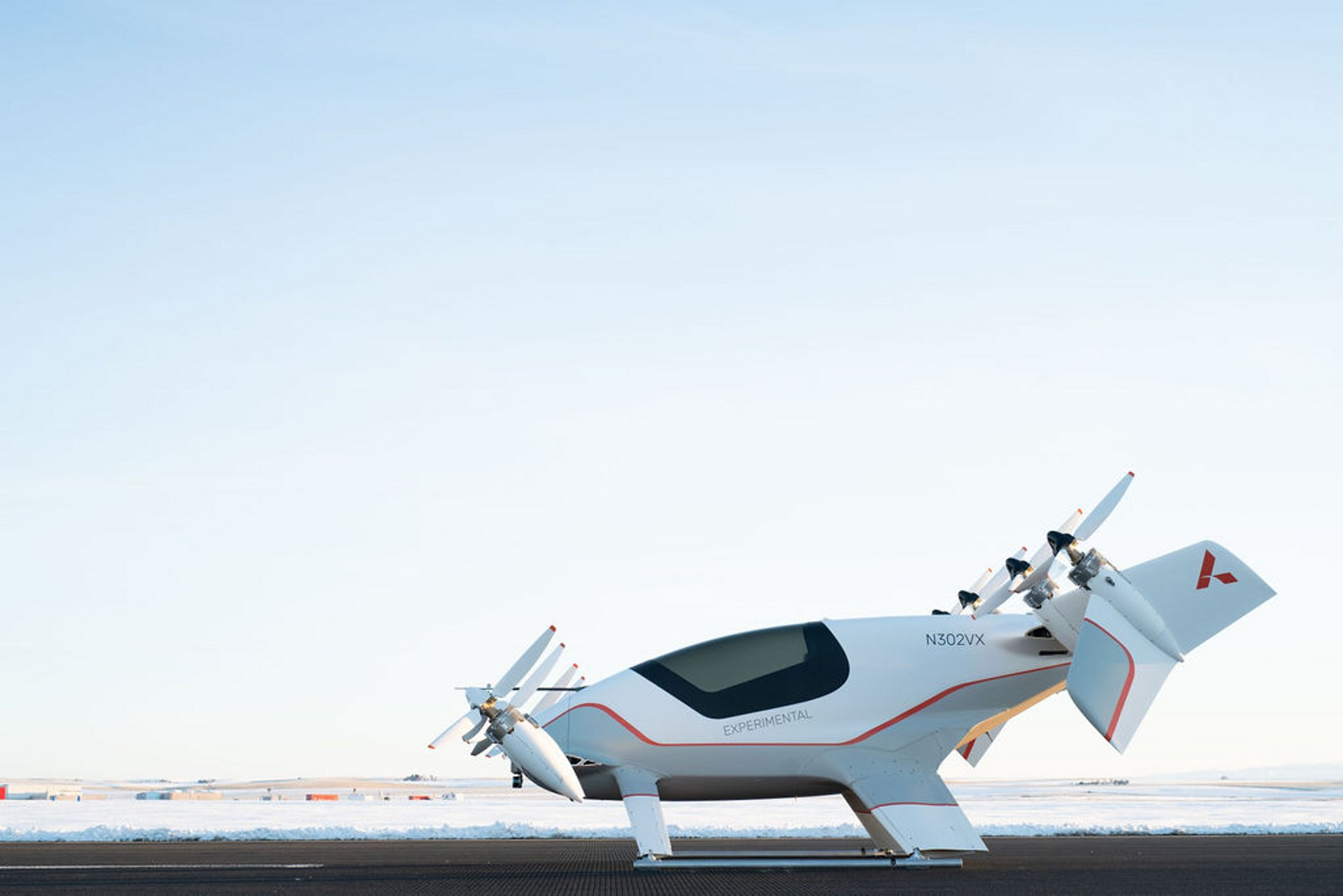 A side view of Airbus' Vahana all-electric, single-seat tilt-wing vehicle demonstrator on the ground.