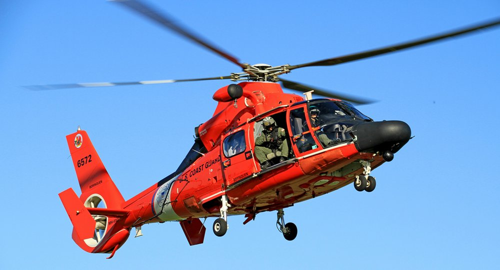 An in-flight AS365 N3+ helicopter configured for search and rescue (SAR) operations.