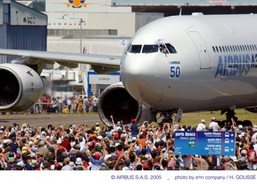 18 June 2005 - A relaxed Claude Lelaie waves to the crowd as the A340-600 taxiies to its parking slot.