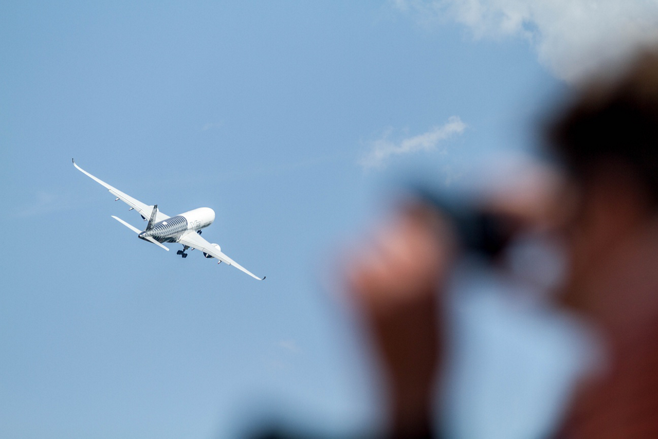 Seen in the skies above the Berlin ExpoCenter Airport at Schoenefeld, Airbus' A350-900 test aircraft performs for crowds at Germany's 2018 ILA Berlin air show