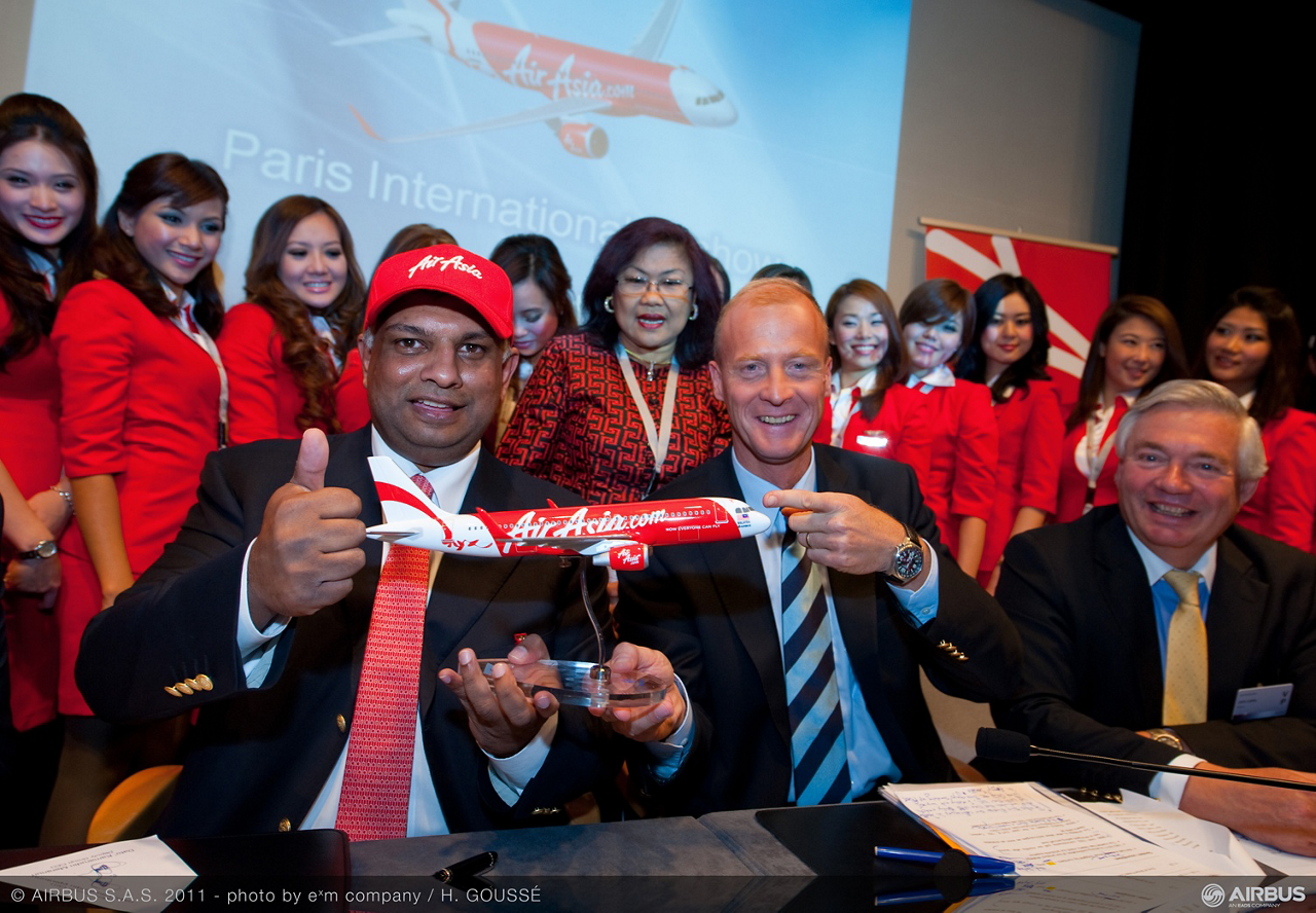 AirAsia's order for 200 Airbus A320neo aircraft is celebrated at the 2011 Paris Air Show.