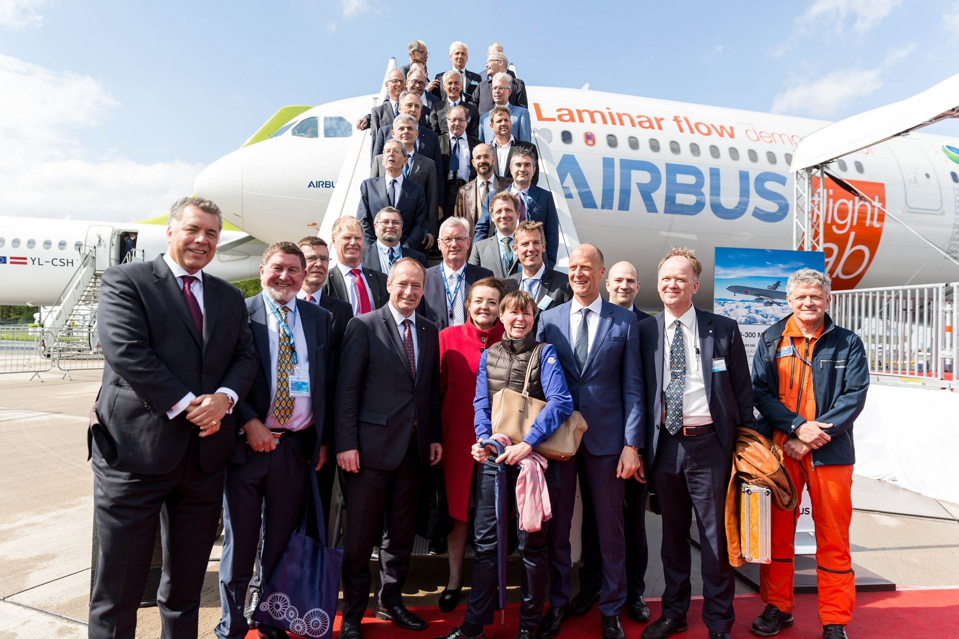 "Airbus showcased its ""Flight Lab"" BLADE test aircraft to EU Clean Sky partners at the ILA Berlin Air Show 2018. Representatives, pictured here with Airbus CEO Tom Enders, included members of the European Parliament, the European Commission, the German Government, European Member States and industrial partners from across Europe."