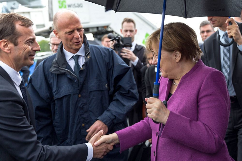 German Chancellor Angela Merkel welcomed by Guillaume Faury and Tom Enders