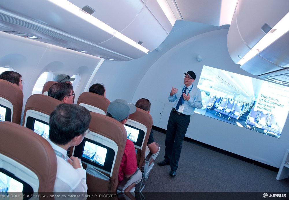 The Airbus Comfort Zone's full-scale cabin mockup is shown at the 2014 Singapore, Airshow during a briefing for attendees on the company's standard 18-inch wide economy class seats.