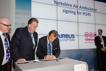 Yorkshire Air Ambulance Signs for H145 at Helitech 2015