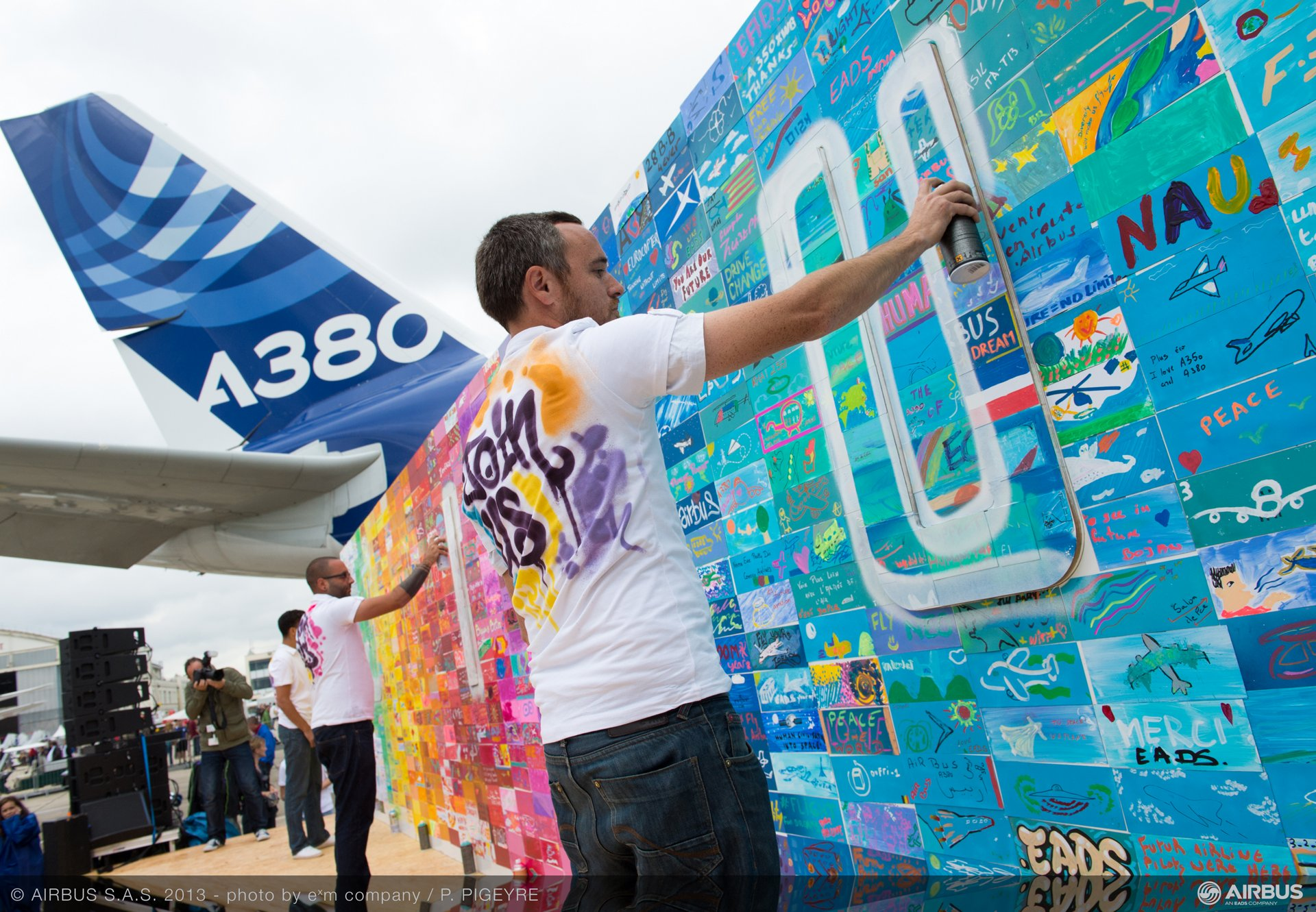 "The special ""Express yourself – design your future"" graffiti mural evolved throughout the show with visitor participation. it's designed to encourage young people, students, graduates, and even experienced professionals to consider careers with EADS."