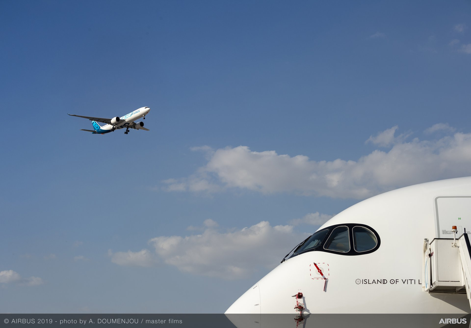 Airbus' A330neo test aircraft showcases its excellent handling qualities during a flight demonstration at the Dubai Airshow, being held 17-21 November 2019 in the United Arab Emirates; Fiji Airways' A350-900 is shown in the foreground