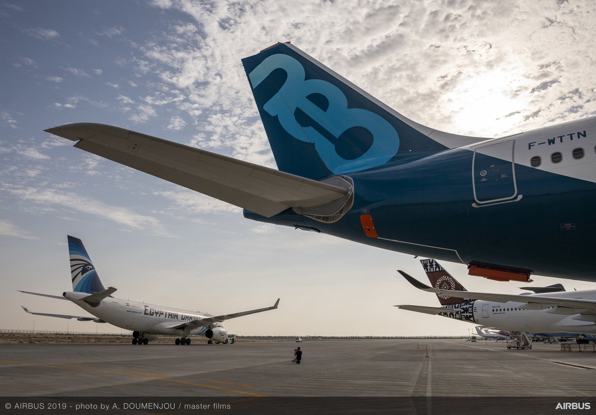 Two wide-body members of Airbus' product line of commercial jetliners – the A330neo and A350 XWB – are shown on display at the 2019 Dubai Airshow, joined by a single-aisle A220-300
