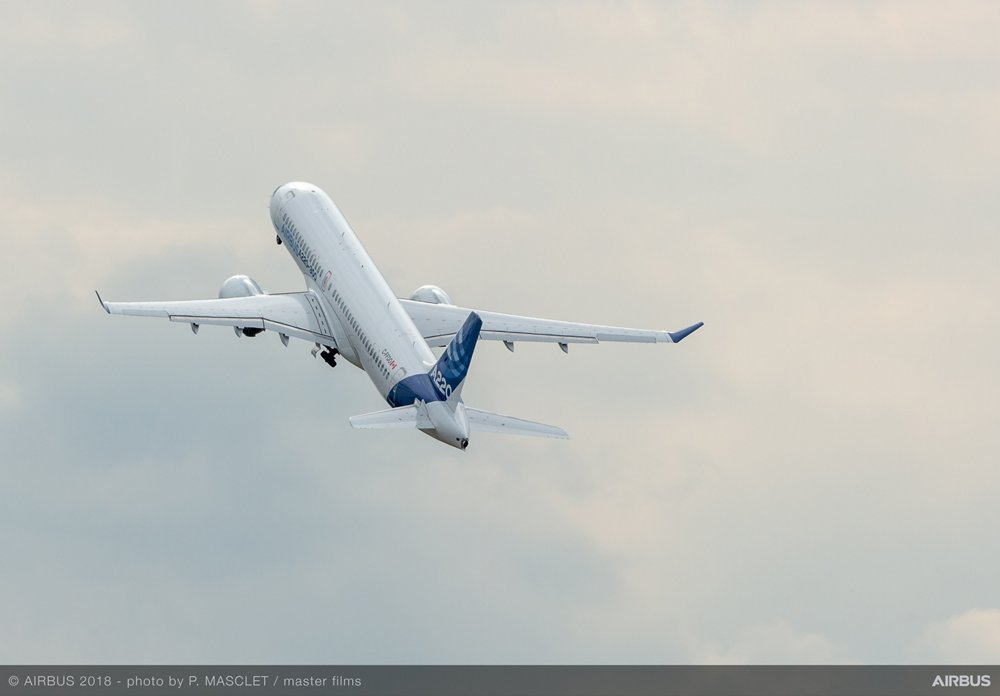 An Airbus A220-300 ascends after takeoff.