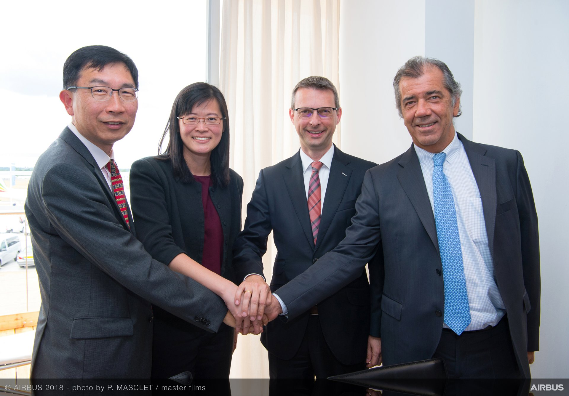 Left to right: DSTA Chief Executive Mr Tan Peng Yam; DSTA Director Air Systems Ms Ngiam Le Na; Airbus Defence and Space Head of Military Aircraft Services Stephan Miegel; and Airbus Defence and Space Head of Military Aircraft, Fernando Alonso after the signing at Farnborough Airshow.