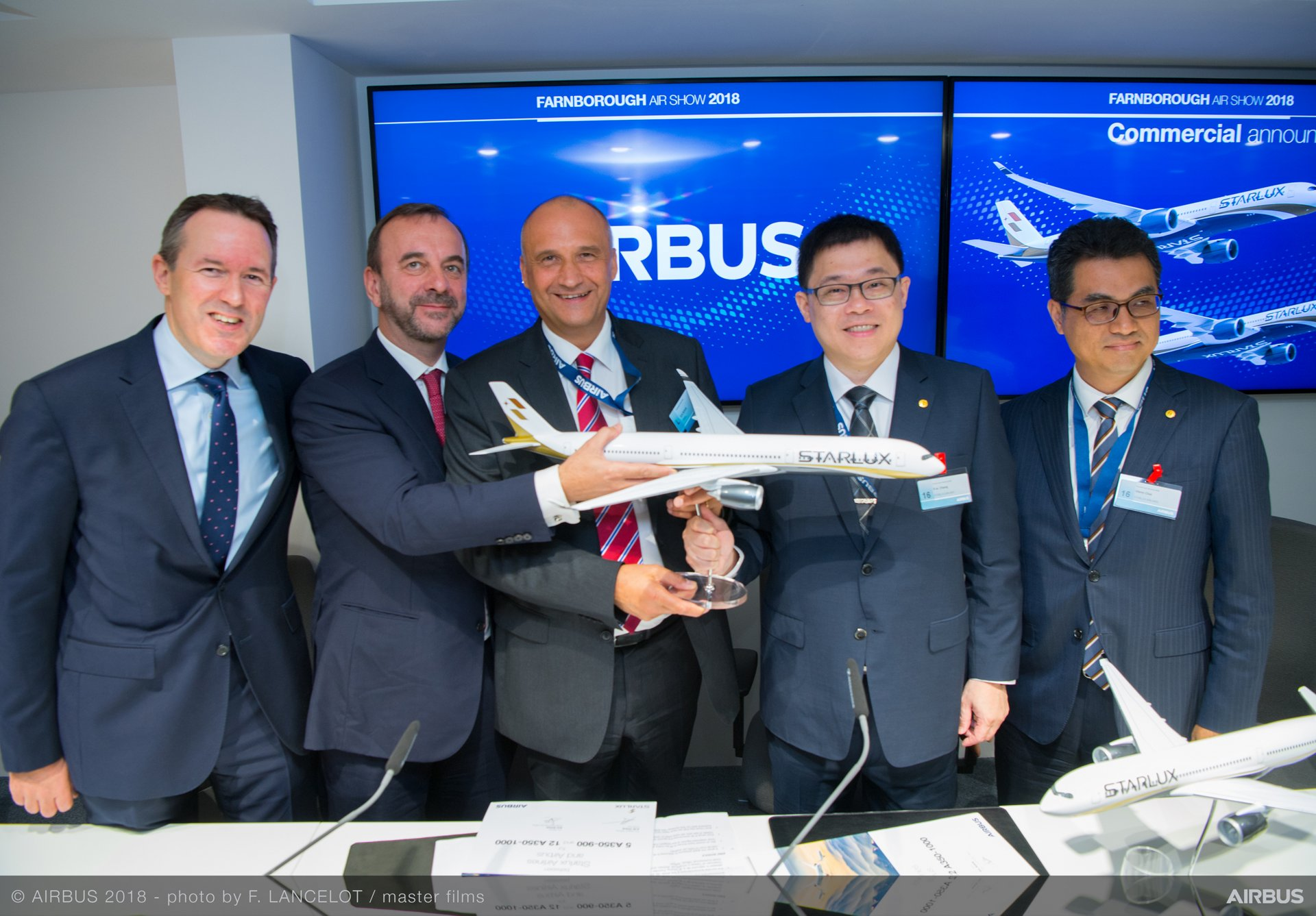 STARLUX Airlines' Memorandum of Understanding with Airbus to purchase 17 A350-1000 jetliners for deliveries beginning in late 2021 was announced at a Farnborough Airshow press conference with (from left to right): Rolls-Royce Chief Customer Officer Dominic Horwood; Airbus Executive Vice President Asia Jean-François Laval; Airbus Chief Commercial Officer Eric Schulz; STARLUX Airlines Founder & Chairman K.W. Chang and STARLUX Airlines President Glenn Chai