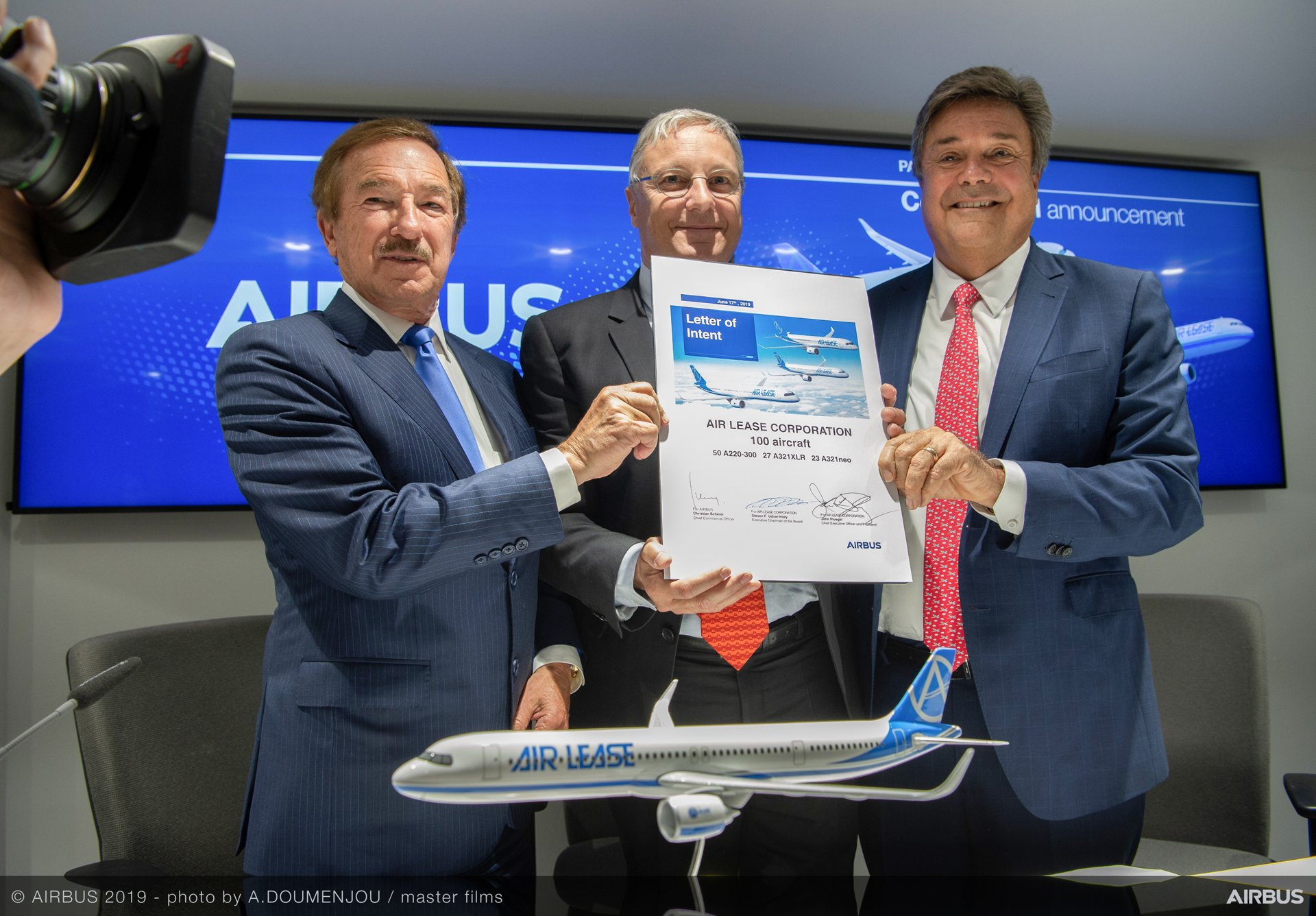 Air Lease Corporation's Letter of Intent for 100 Airbus aircraft – comprised of 50 A220-300s, 27 A321XLRs and 23 A321neos – is marked at the 2019 Paris Air Show by (from left to right): Steven F. Udvar-Házy, Air Lease Corporation Executive Chairman of the Board; Airbus Chief Commercial Officer Christian Scherer; and John Plueger, Air Lease Corporation CEO and President