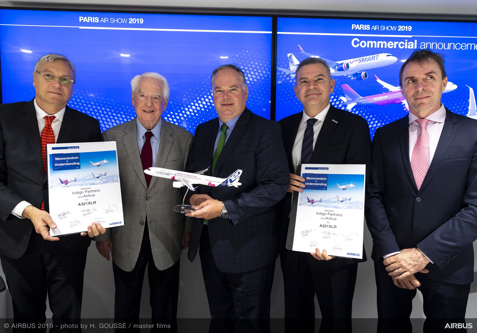 Indigo Partners' Memorandum of Understanding for 50 A321XLR aircraft – to be operated by Frontier Airlines, JetSMART and Wizzair – is marked at the 2019 Paris Air Show by (from left to right): Airbus Chief Commercial Officer Christian Scherer; Bill Franke, President of Frontier Airlines; Barry Biffle, Chief Executive Officer of Frontier Airlines; Estuardo Ortiz, Chief Executive Officer & Founder of JetSMART Airlines; and Jozsef Varadi, Chief Executive Officer of Wizzair