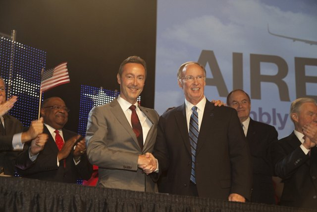 Airbus President & CEO Fabrice Brégier (at left) and Alabama Governor Robert Bentley pose for international journalists during the 2 July 2012 event announcing the new A320 Family jetliner production facility in Mobile, Alabama