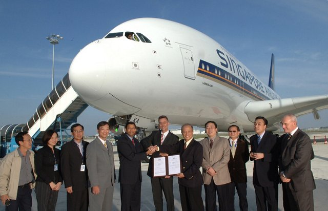 Singapore Airlines managers, flight crew and Airbus programme personnel proceed with the formal Transfer of Title for the A380's first customer delivery (15 October 2007)