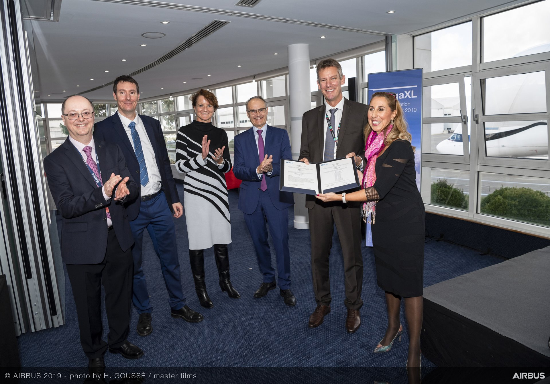Celebrating the BelugaXL airlifter's Type Certification in November 2019 are, from left to right: Florentino Bascunana, BelugaXL Project Certification Manager at EASA; Sébastien Freissinet, Airbus BelugaXL Type Certification Manager; Veronique Roca, Airbus BelugaXL Technical Director and Chief Engineer; Bertrand George, Airbus Sr. VP & Head of BelugaXL Programme; Jean-Brice Dumont, Airbus Executive VP - Engineering; Carla Iorio, EASA, Head of CT1.4 Special Aeroplanes & Projects
