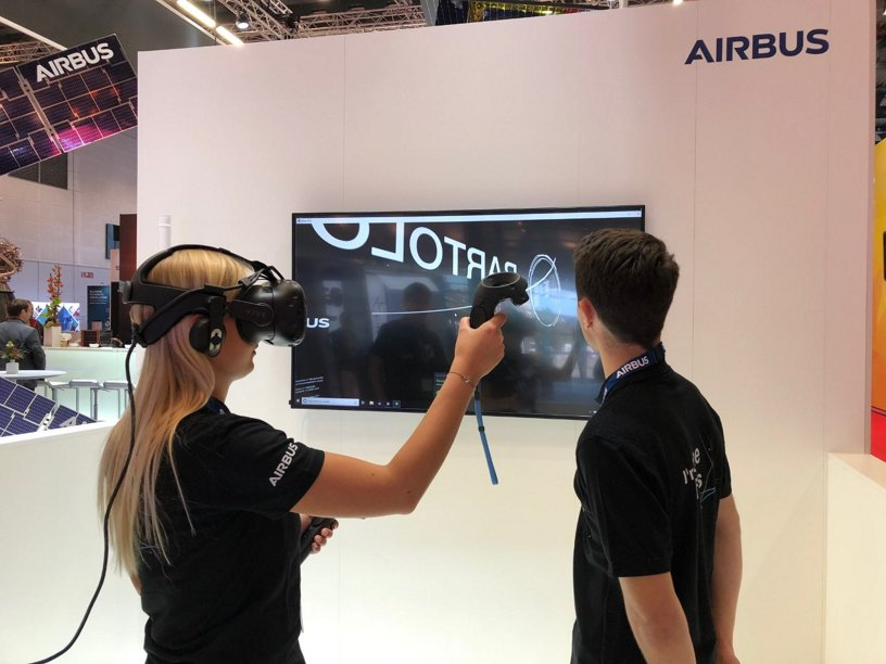 Virtual Reality demonstration at the Airbus booth during the 2018 IAC 2018
