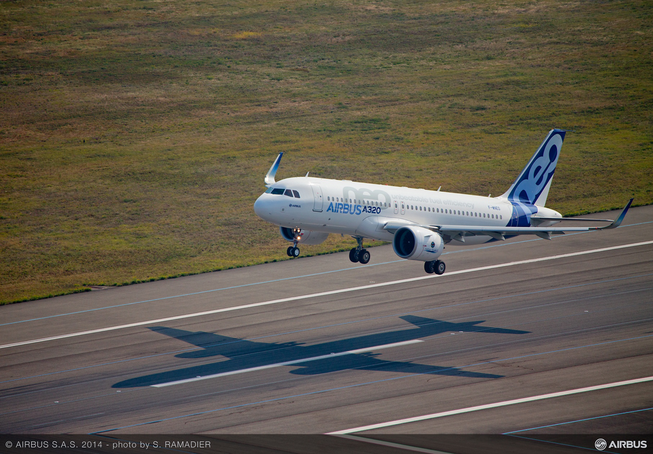 The first A320neo jetliner to fly lifts off the ground at Toulouse-Blagnac Airport's Runway 32L to begin its landmark 25 September 2014 maiden flight
