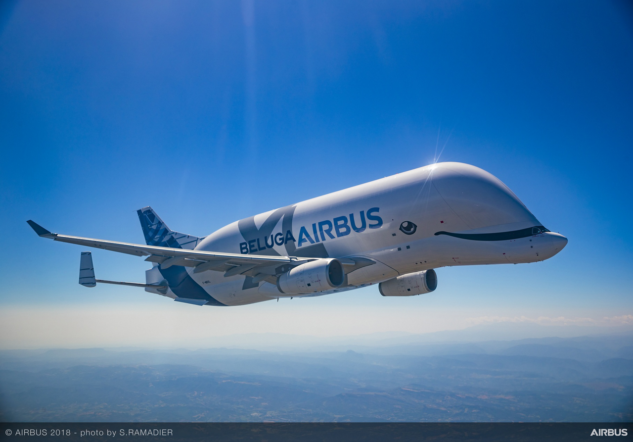 Airbus' first BelugaXL oversize cargo airlifter is shown in flight.