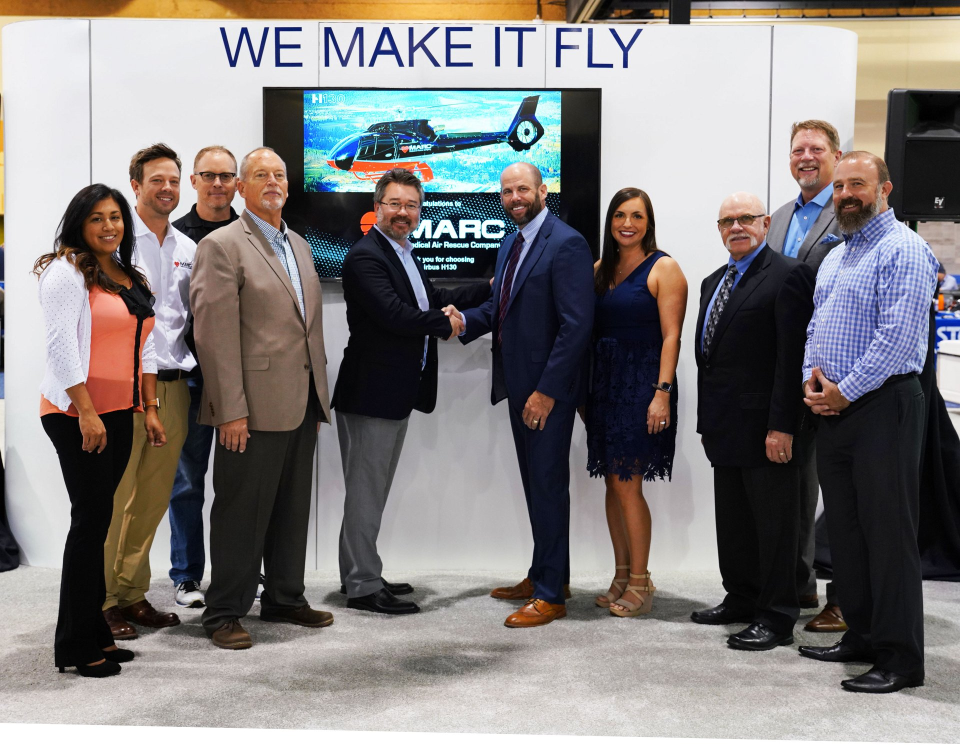 "Chris Emerson, Airbus Helicopters Inc. President,  shakes hands with Paul ""Monty"" Renfro, CEO of MARC, along with the Airbus Helicopters Inc. and MARC teams."