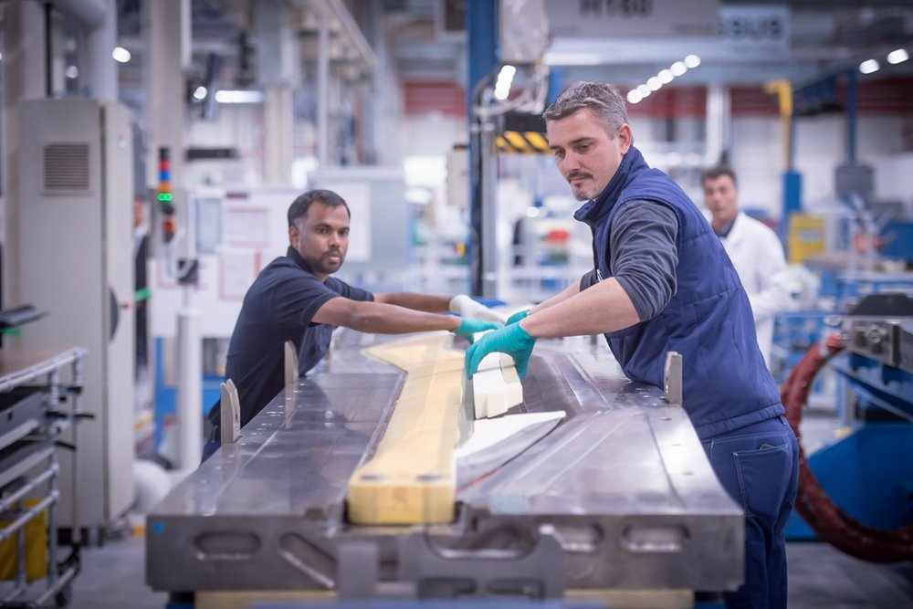 Airbus employees specialising in rotor blade production work at the company's Dugny site in France.