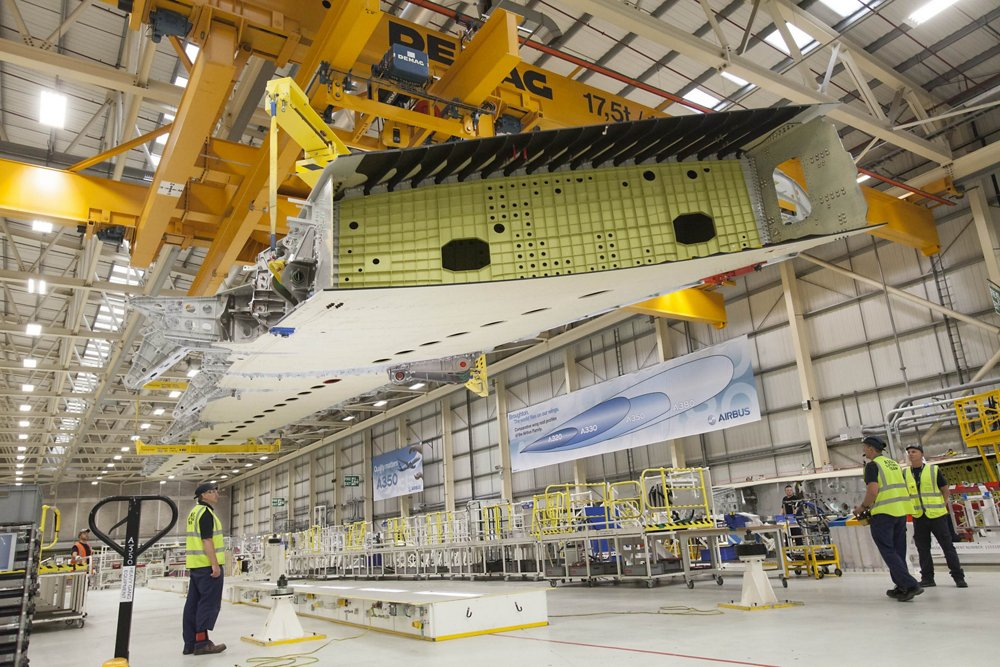 Activity related to A350 XWB wing assembly is shown at Airbus' Broughton facility in North Wales