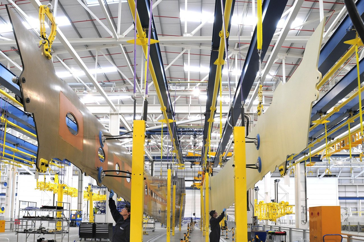 Suspended lower and upper all composite A350 XWB wing covers in new Airbus wing factory at Broughton, Wales-UK