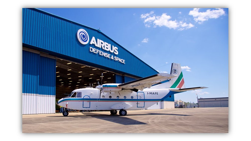 A C212 aircraft is parked outside the Airbus DS Military Aircraft, Inc. facility in Mobile, Alabama, USA.