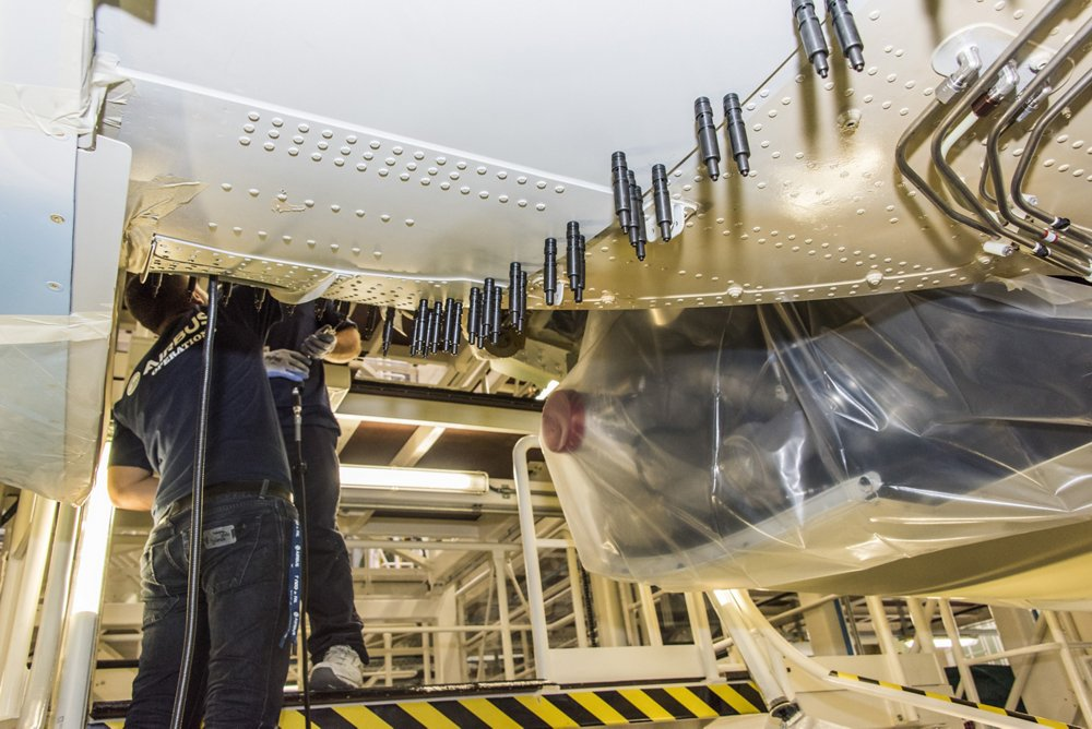 Production employees work on an A320 Family aircraft at the Airbus U.S. Manufacturing Facility in Mobile, Alabama.