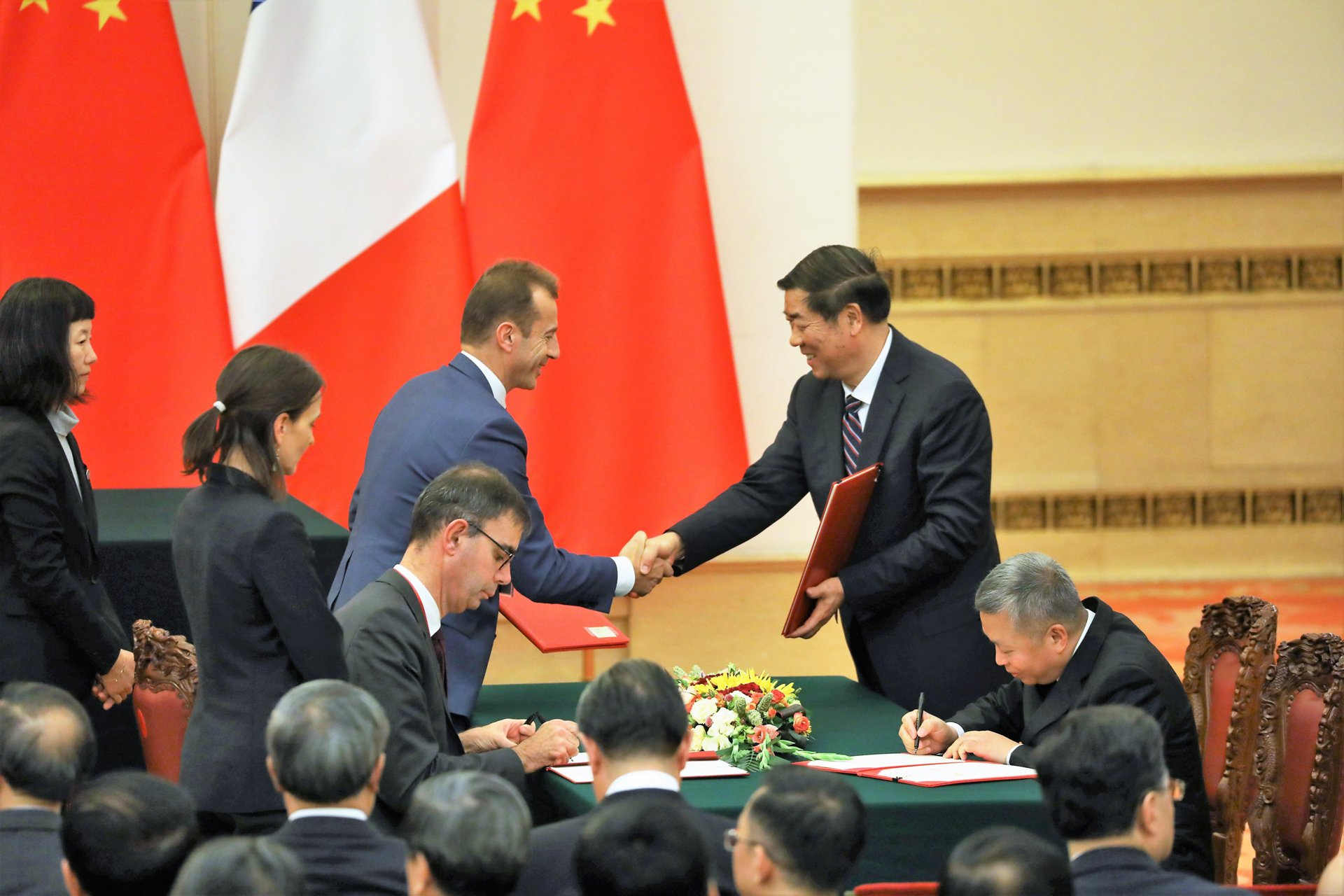 Airbus CEO Guillaume Faury shakes hands with Chinese National Development and Reform Commission President He Lifeng after the signing of an agreement at the Great Hall of People during French President Emmanuel Macron's official visit in Beijing on 6 November 2019