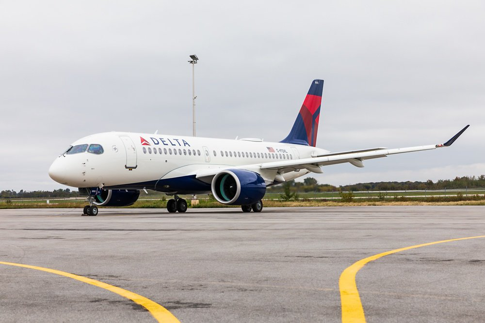 An on-ground view of an A220 commercial aircraft in the livery of U.S. operator Delta Air Lines.