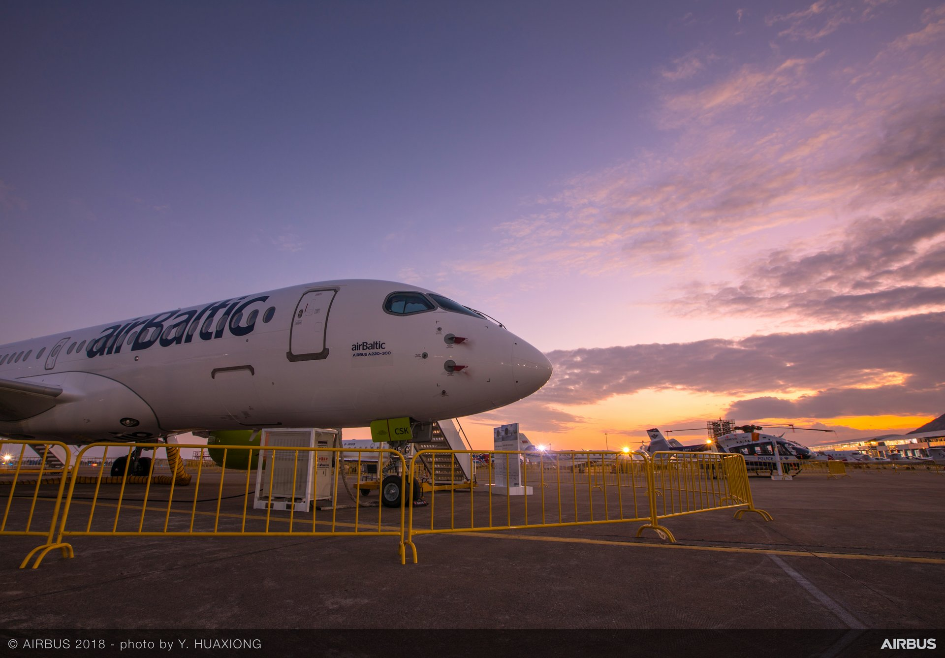 A220-300 Air Baltic on ground with sunset